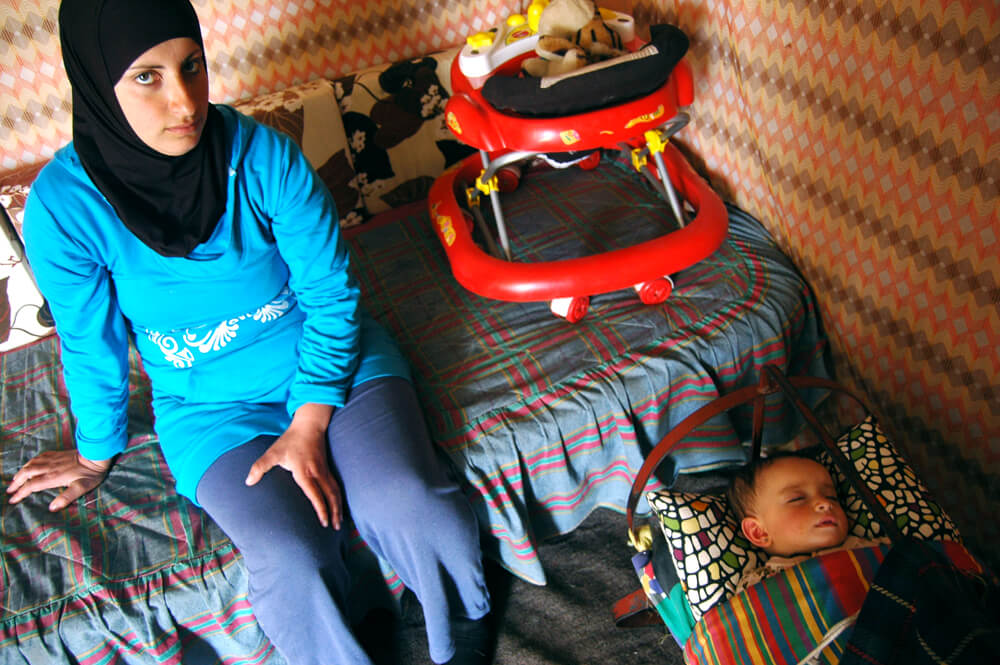 Hiam al-Nawaja (L) and Dahlia al-Nawaja in their home, Susiya, the West Bank. (Photo: Allison Deger)