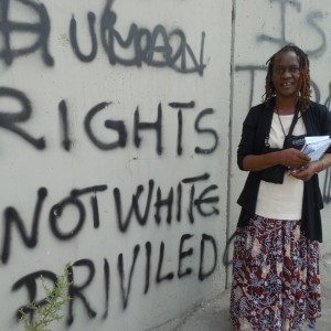 Delegate Jennifer Copeland at the Separation Wall. (Photo: IFPB)