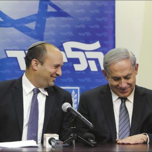 Israeli Prime Minister Benjamin Netanyahu, right, and Jewish Home chairman Naftali Bennett announce the formation of a coalition government Wednesday shortly before the task of forming government would have been given to another party. (Photo: Gali Tibbon/AFP/Getty Images/AP)