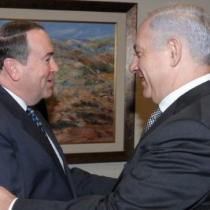 Former Arkansas governor Mike Huckabee meets Prime Minister Benjamin Netanyahu in Jerusalem during a 2011 visit. Actor Jon Voight smiles in the background. (Photo: Amos BenGershom/ GPO/Flash90)