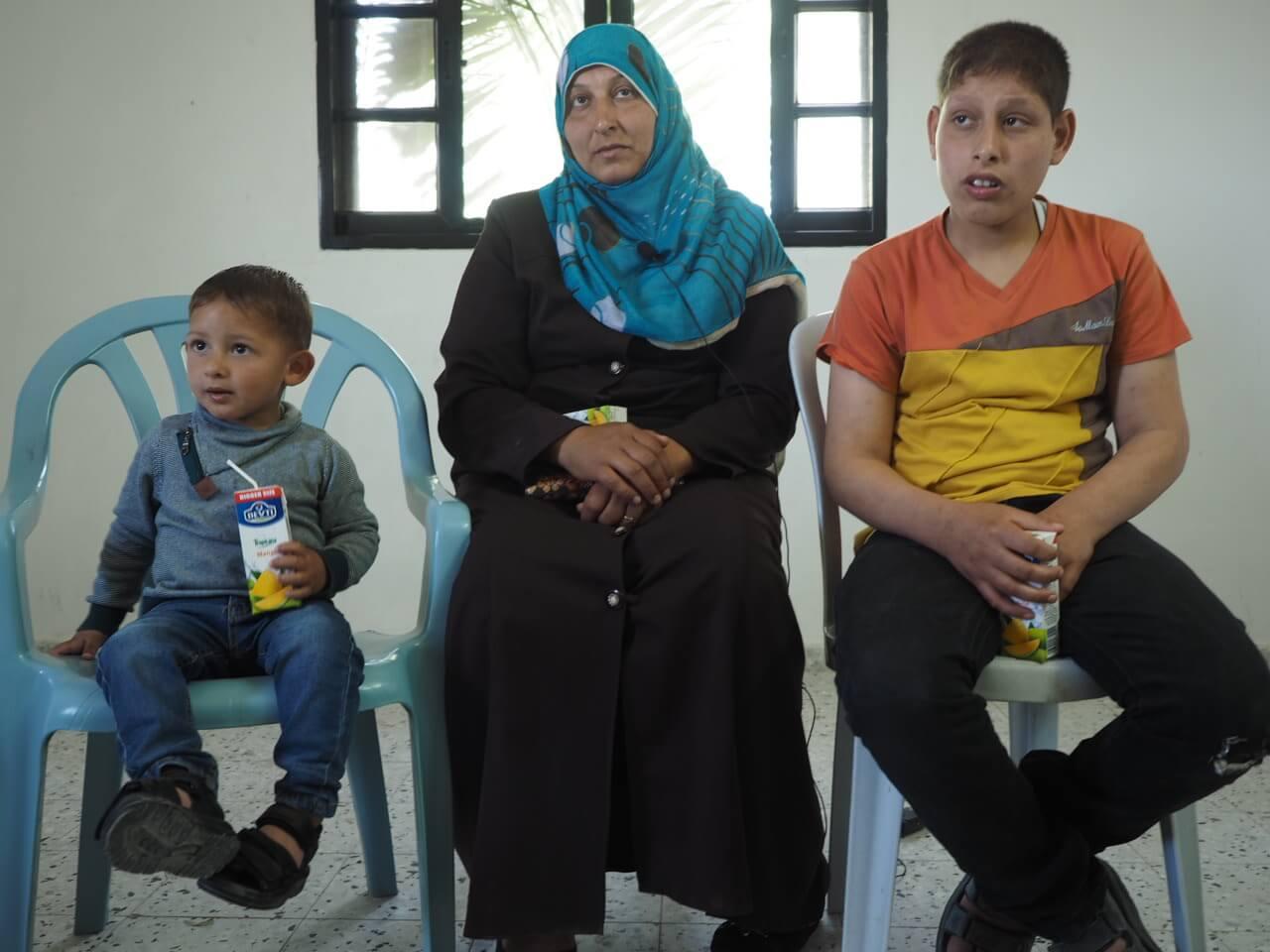 Um Ahmad Najjar and her two sons Rayan and Ahmad. (Photo: Dan Cohen)