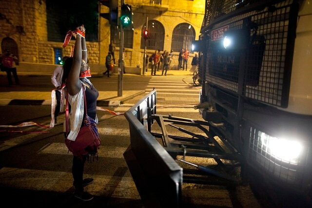 An Ethiopian Israeli blocking a police vehicle in a protest against police brutality, in Jerusalem on April 30 (Photo: Lior Mizrahi)