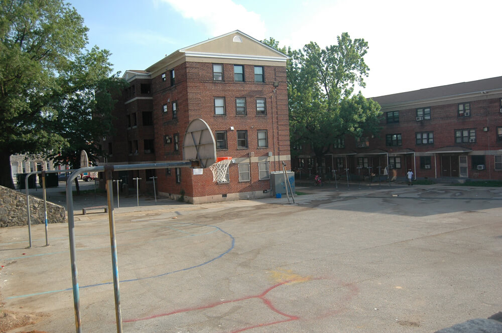 Basketball courts in Gilmor Homes, Baltimore. (Photo: Allison Deger)