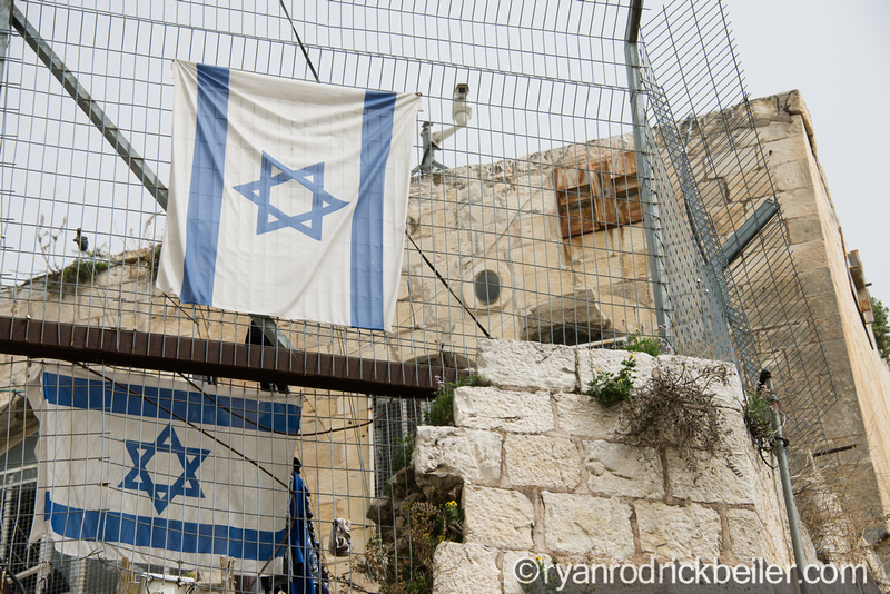 Israeli flags hang from a Palestinian property taken over by settlers in the Muslim Quarter of the Old City of Jerusalem, March 3, 2014. Though annexed by Israel in 1967, the international community considers East Jerusalem, including the Old City, to be occupied Palestinian territory. (Photo: Ryan Rodrick Beiler)