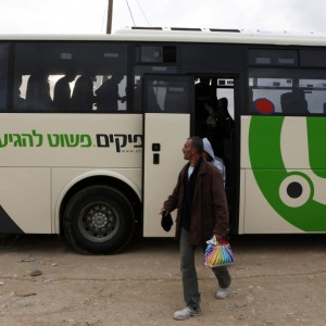 Workers disembark a Palestinian bus before crossing through Israel's Eyal checkpoint as they return to a crossing near Qalqilya on Monday. (Photo: Reuters)