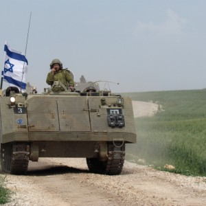 Israeli tank rolls through village of Ibziq in the northern Jordan Valley, March 2014. The military operations at that time caused 20 families to be evacuated from their homes. (Photo: Ecumenical Accompaniment Programme in Palestine and Israel (EAPPI)/T. Kopra)