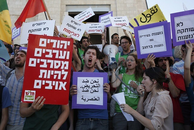 Israeli leftists protest a Jerusalem Day march on 17 May 2015. (Photo: AFP/Gali Tibbon)