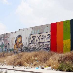 Rainbow flag on the separation wall.