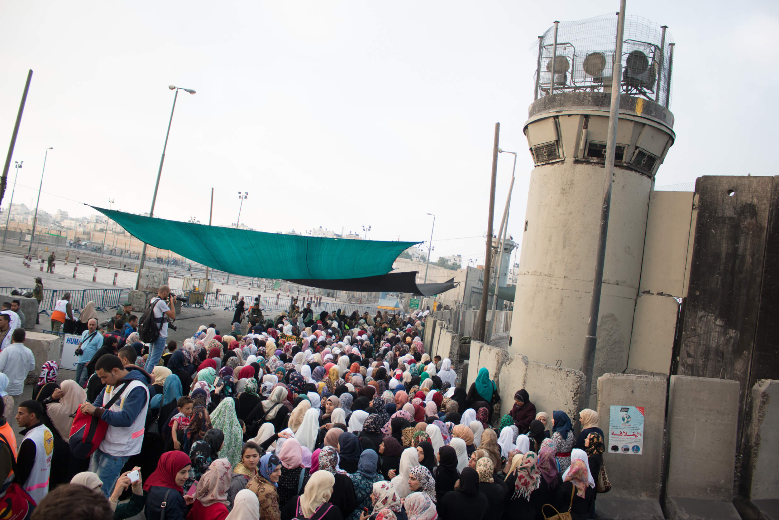 Most Palestinian women from the West Bank are allowed to cross through Qalandia without permits on Fridays during Ramadan, even though Israeli regulations stipulate that permits are needed for those under 40. (Photo: Karam Saleem)