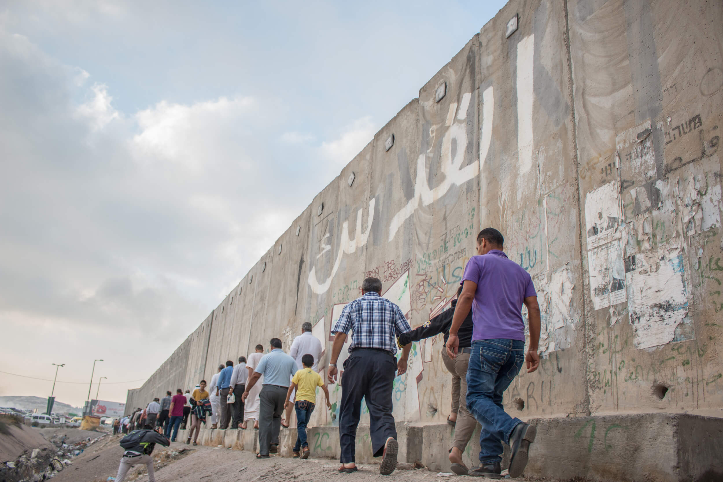 Men over 50 years old do not need a permit to cross through Qalandia, while younger men need permission from the Israeli government. (Photo: Karam Saleem)