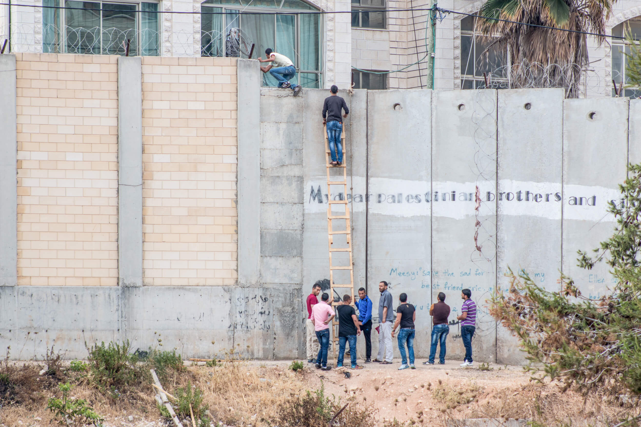 After being dispersed by Israeli authorities, Palestinians trying to cross illegally change to another prepared location. (Photo: Karam Saleem)