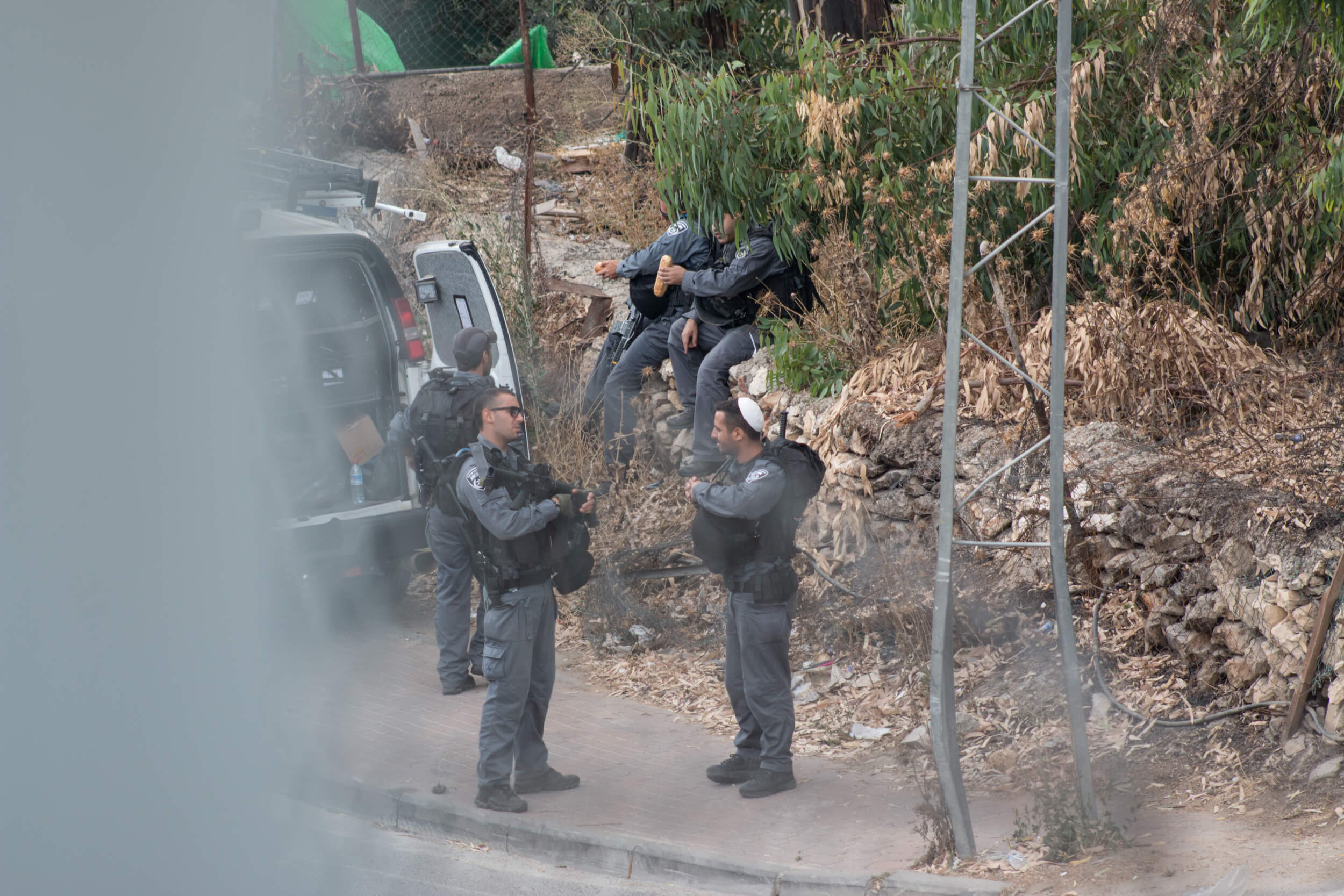 Israeli riot police wait on the other side after jeeps arrived on the West Bank side of the wall to disperse those trying to cross.(Photo: Karam Saleem)