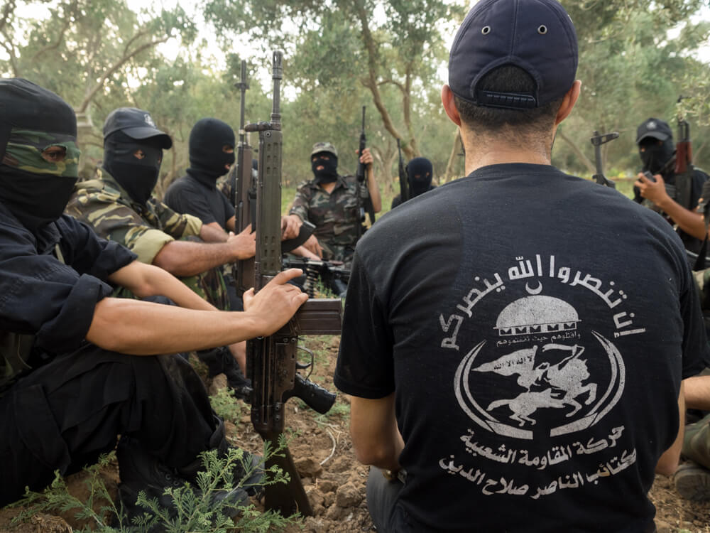 Abu Sayyaf debriefs his battalion after training exercises. (Photo: Dan Cohen)