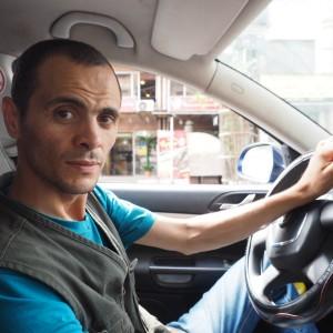 Mohammed Zaidan in his taxi in Gaza City. (Photo: Dan Cohen)