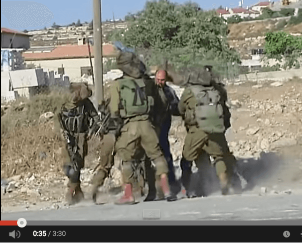 Soldiers surround and capture Palestinian man