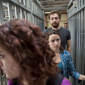 Artists, including the author, center, traveling with the Palestine Festival of Literature travel through the Qalandiya checkpoint on May 24, 2015 in Ramallah, Palestine. (Photo: Rob Stothard for The Palestine Festival of Literature)