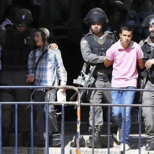 Israeli security forces arrest a Palestinian man during clashes after Israeli authorities limited access for Muslim worshipers to the flashpoint al-Aqsa mosque compound in the old city of Jerusalem on July 26, 2015. Israeli police entered the compound, one of Islam's holiest places, to tackle suspected Palestinian rioters, police said. AFP PHOTO / AHMAD GHARABLI