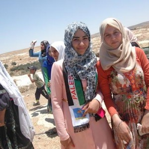 Young women at Susiya demonstration against the town's impending demolition. July 24, 2015/Photo: Allison Deger