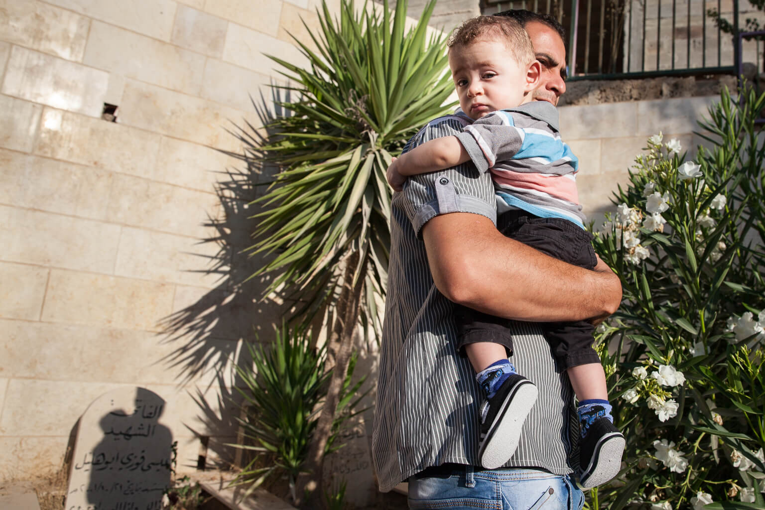 Iyad Al-Dibbis and his son. (Photo: Rebecca George)