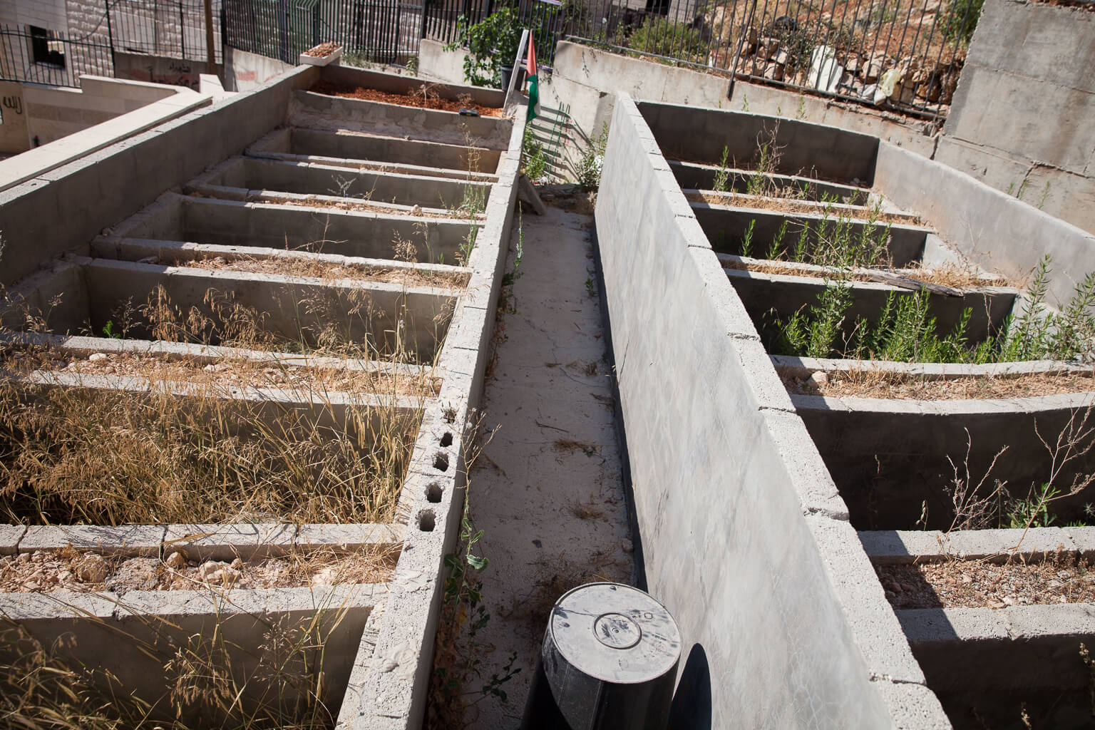 Eleven empty plots wait at the top of the Martyr's Cemetery.  When the new plots were added in 2013, it made local news, adding to rumors of a third Intifada. (Photo: Rebecca George)