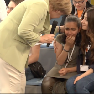 Angela Merkel consoles 14-year old Reem Sahwil after bringing her to tears when explaining Germany's need to deport asylum seekers. (Photo: Gut Leben/Newsweek Europe)