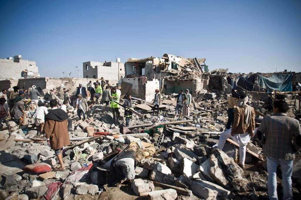 Yemenis search for survivors in the rubble of houses destroyed in Saudi airstrikes in Sana'a, Yemen in March 2015  (Photo: Hani Mohammed/AP)