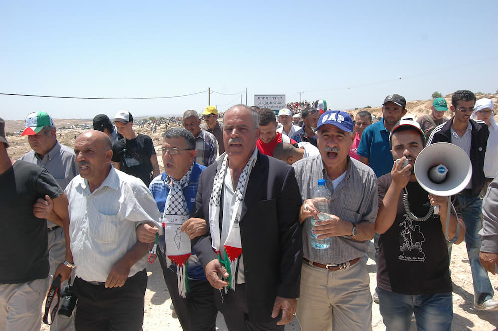 Palestinians from Susiya lead protest against the upcoming demolition of their village. (Photo: Allison Deger)