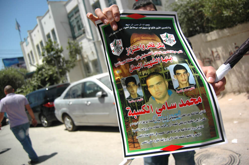 Martyr's poster for Mohammed Hani al-Kasbah, 17, killed by the Israeli military Friday morning near Qalandia checkpoint, Qalandia refugee camp. (Photo: Allison Deger)