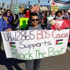 """UAW Local 2865 member and UC PhD candidate Kumars Salehi representing the union at a """"Block the Boat"""" protest."""