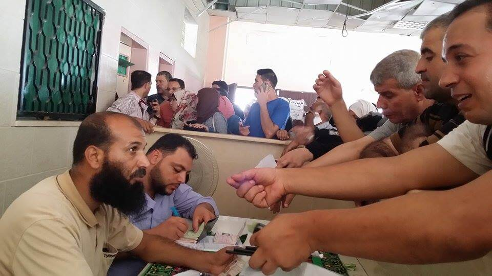 People who want to travel get their passports checked. (Photo: Isra Saleh El-Namy)