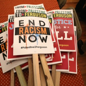 A stack of signs from the Palestine Contingent to Ferguson October. Photos of a Palestine2Ferguson sign at the main march during Ferguson October. (Photo by Christopher Hazou)