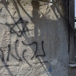 "Jewish star and ""Revenge"" Graffiti on the wall of Palestinian home firebombed in West Bank over weekend, Getty Images"