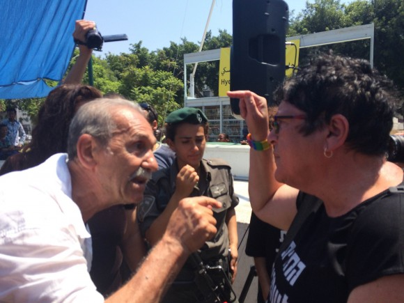 Israeli Black Panther Reuven Abergil (left) confronts a right-wing Israeli disruptor, photo by Dan Cohen