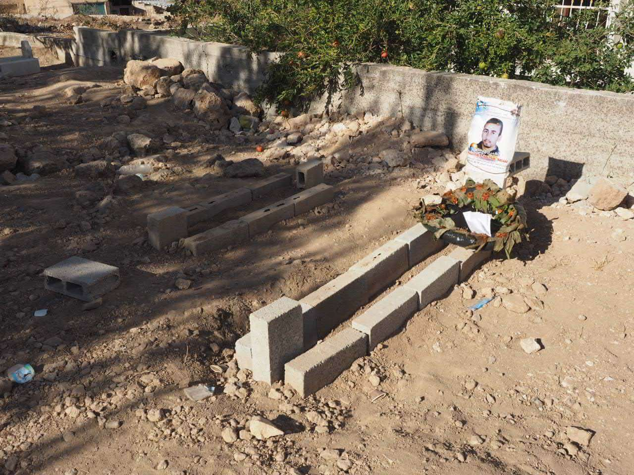 The freshly buried graves of baby Ali and his father, Sa'ad Dawabshe. (Photo: Dan Cohen)