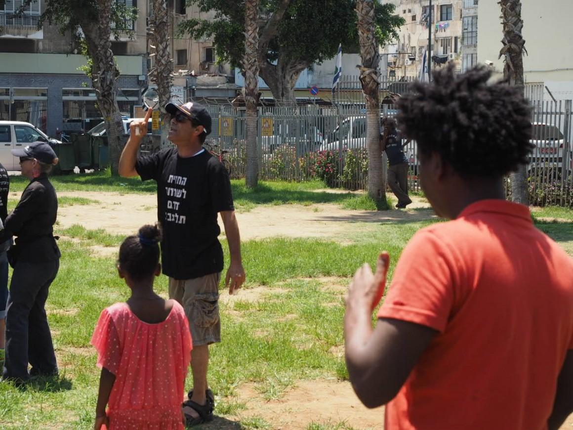 An Israeli demonstrator shouts at African asylum seekers in Levinsky Park, Tel Aviv, photo by Dan Cohen