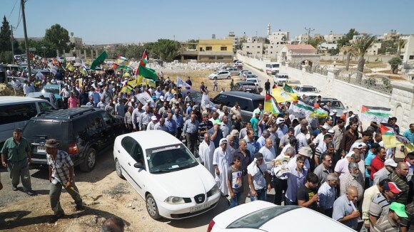 The funeral procession walks from the Dawabshe home to the graveyard. (Photo: Dan Cohen)