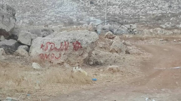 "Arsonists spray paint ""administrative revenge"" near burned Bedouin tent. (Photo: Zakaria Sadah/Rabbis for Human Rights)"