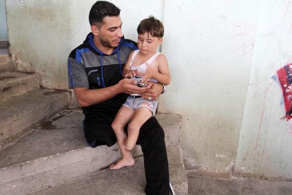 A father and son who both lost legs in Operation Protective Edge, Gaza 2014.