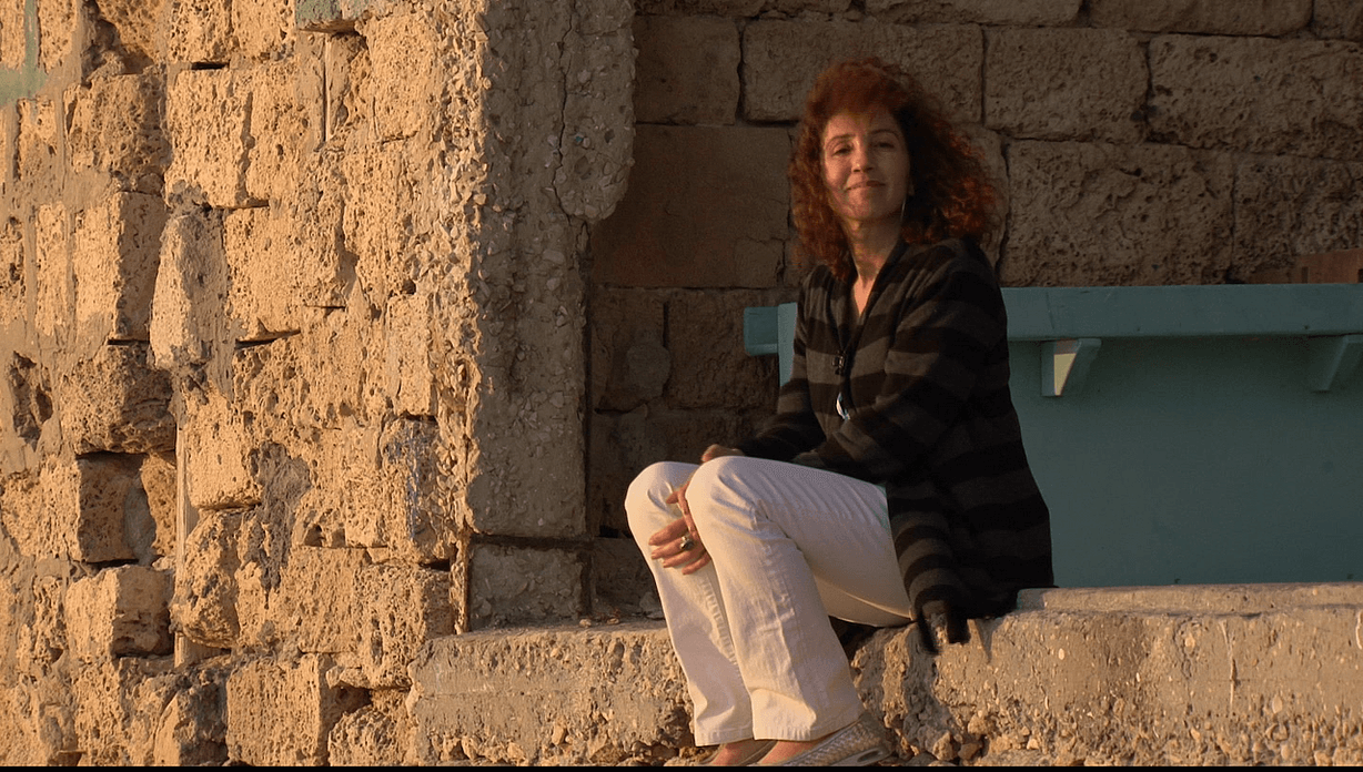 Hala Gabriel on ruin of her family home.