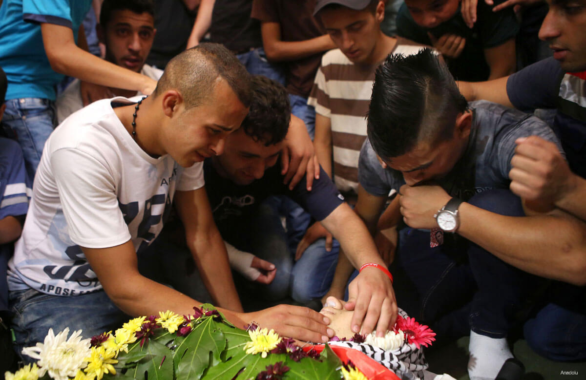 Relatives and friends of 17-years-old Laith al-Khalidi…mourn during his funeral ceremony in Jifna town of Ramallah, West Bank on August 01, 2015. (Photo: Shadi Hatem – Anadolu Agency)