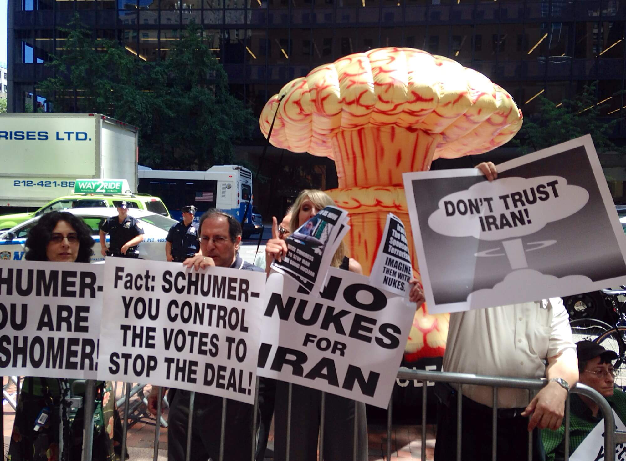 Supporters of Schumer's decision demonstrate against the deal in front of a large inflatable mushroom cloud. (Photo: Eamon Murphy)