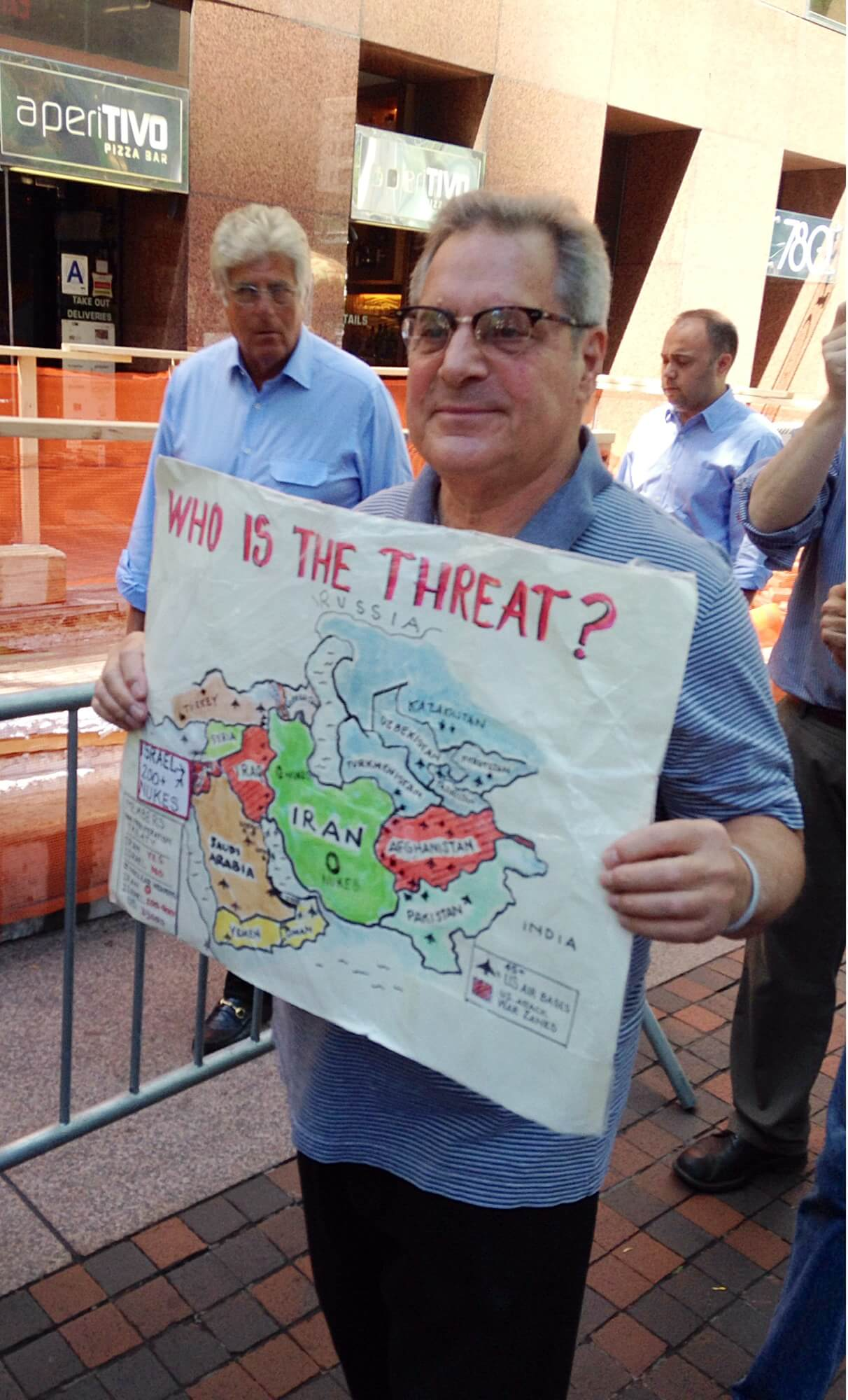 A pro-deal protestor displays a map detailing Israel's nuclear arsenal and U.S. military bases in the region, as well as the Nonproliferation Treaty membership statuses. (Photo: Eamon Murphy)