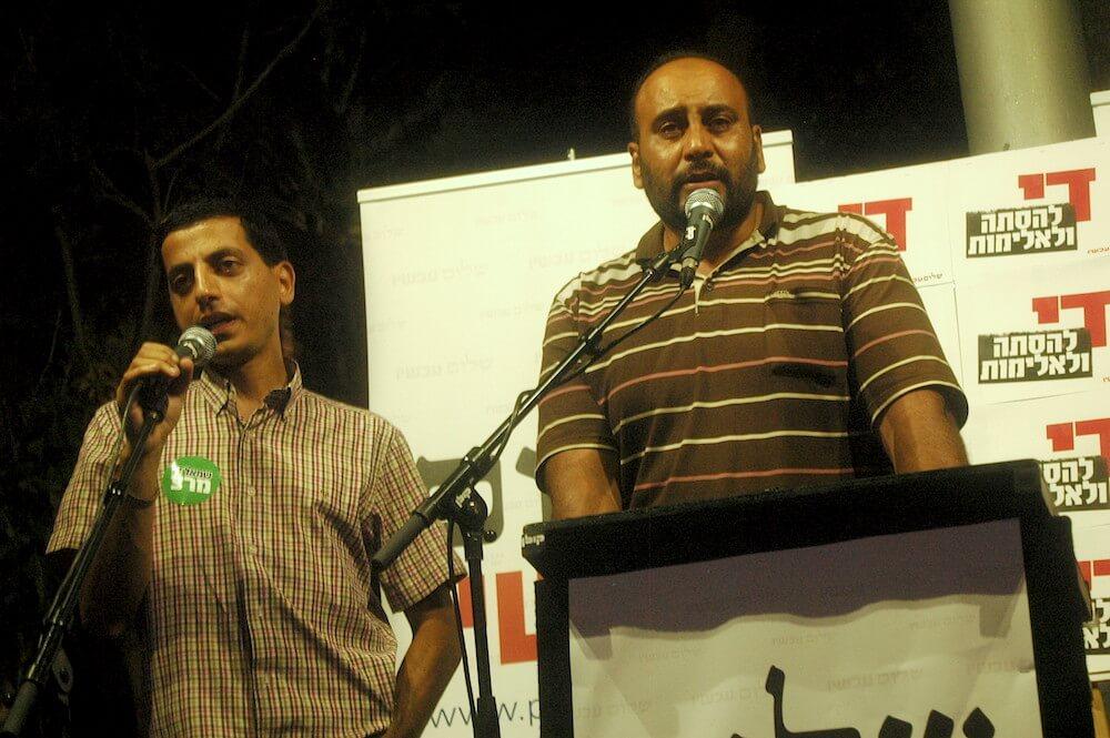Nasser Dawabshe (R) addresses 2,000 Israelis at an anti-terror rally in Tel Aviv, 1 August 2015. (Photo Allison Deger)