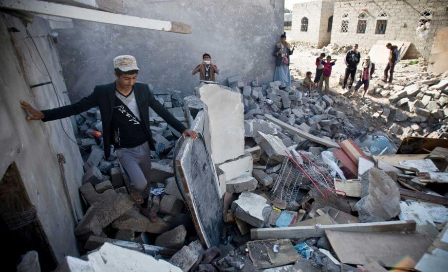 Yemenis in the rubble of homes destroyed by Saudi-led air strikes in capital city Sana'a.  CREDIT: Hani Mohammed / AP