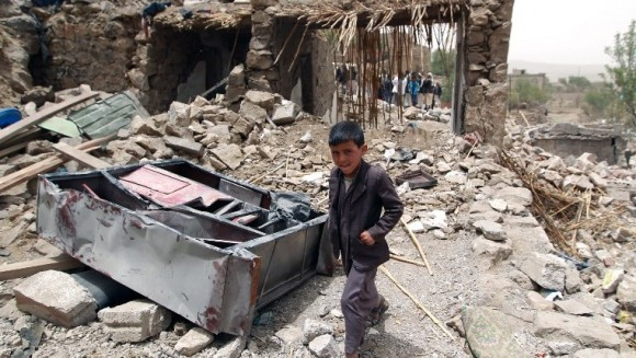 A Yemeni boy walks past the rubble of homes destroyed by Saudi airstrikes. (Photo: AFP / Mohammed Huwais)