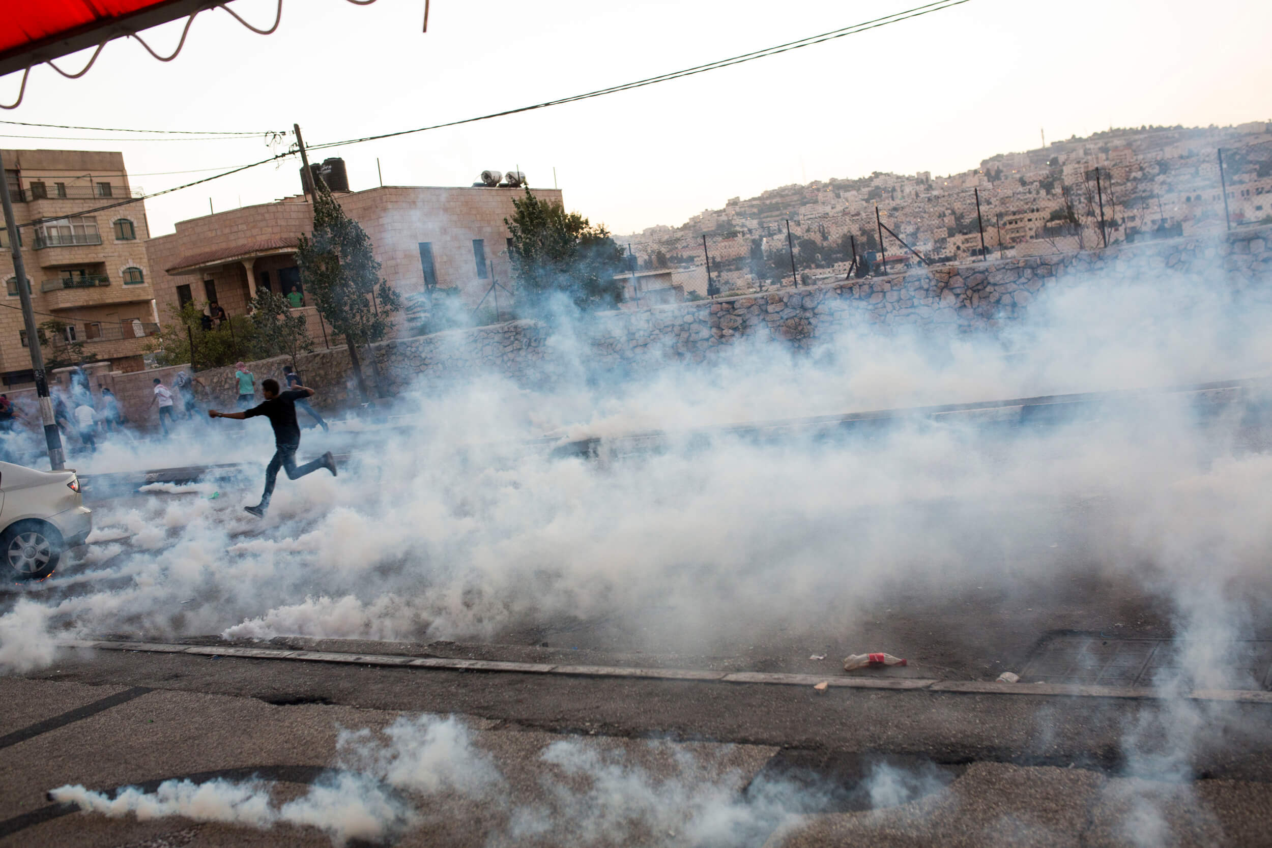 The Israeli army used scores of tear gas canisters, at times covering the Al-Azzeh refugee camp with clouds of tear gas. Some of the tear gas were shot directly at the head level of the protesters. (Photo: Anne Paq)