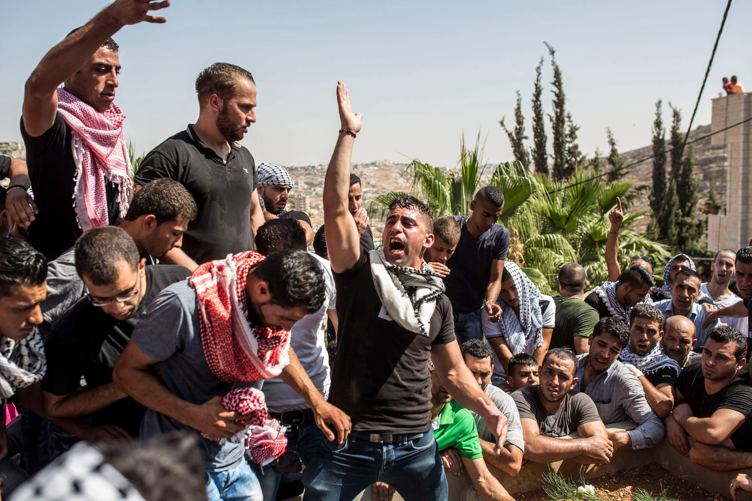 'We are so sad. He was my friend. The Israeli soldiers do not see us as humans.', says a young Palestinian who attended the funeral. (Photo: Anne Paq)