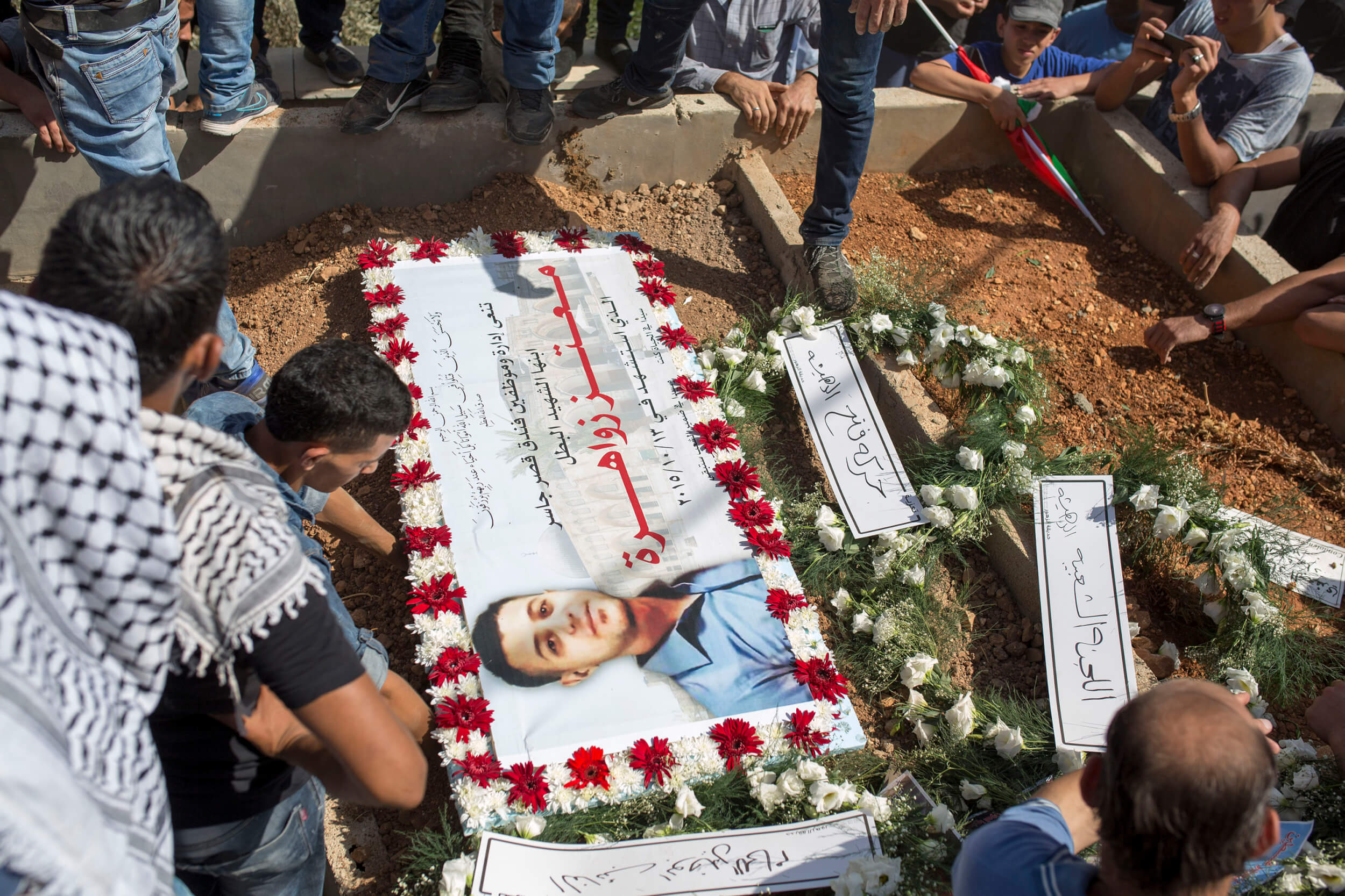 A photo of Mutaz put on his grave in the cemetery of Deheishe refugee camp. (Photo: Anne Paq)