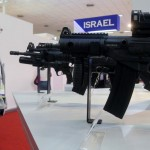 A visitor looks at a model of an Israeli rifle at the Israel pavilion at the Defexpo India 2014, in New Delhi, India, 06 February 2014. (Credit: EPA)
