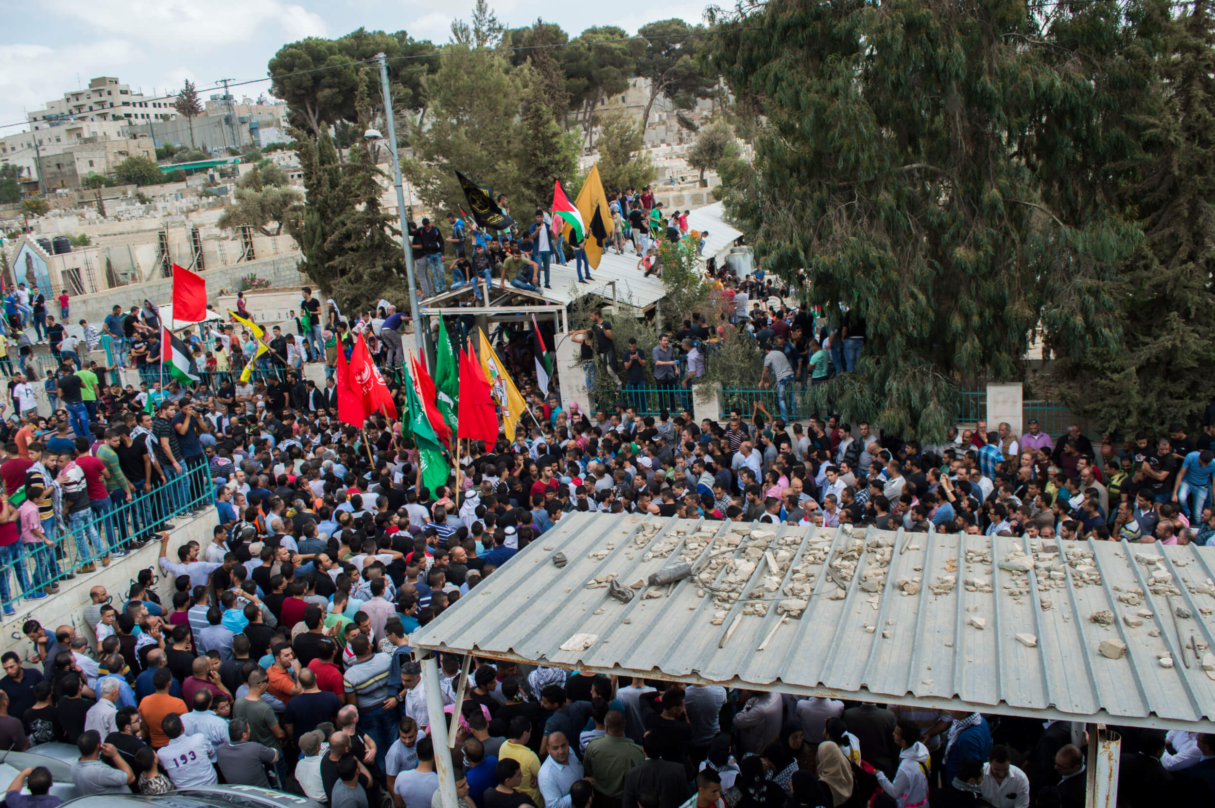 More than a thousand mourners attended the funeral of the 13-year-old boy shot dead by Israeli forces. (Photo by Abed al Qaisi)